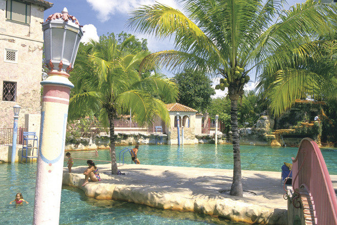 Visitors enjoy the relaxing environment at the City of Coral Gables' Venetian Pool.