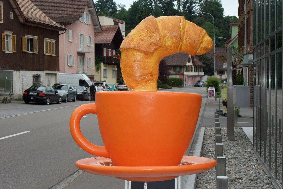 Note: this is not a real croissant (or cup of coffee)