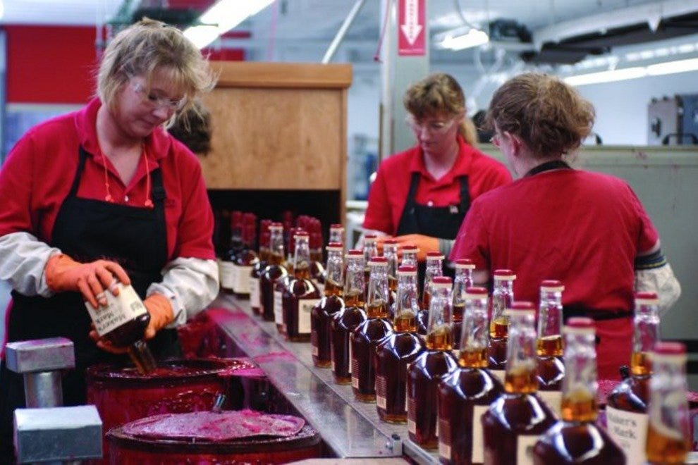 Hand-dipping each bottle in red sealing wax