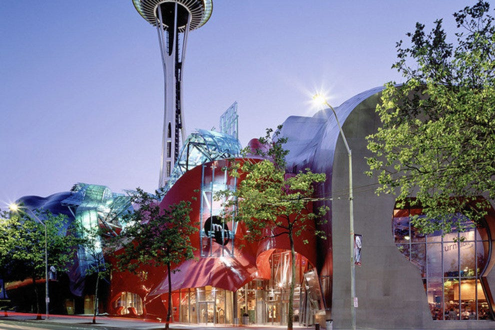 The Space Needle towers above the Experience Music Project, both at Seattle Center.