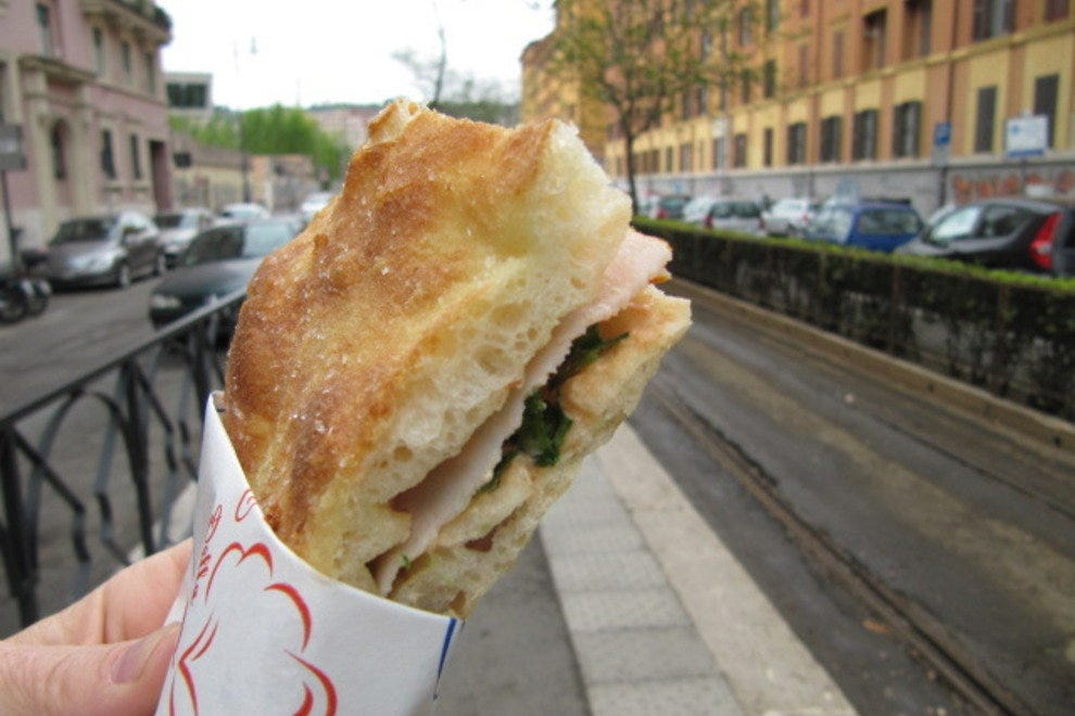 Enjoying a panino in the streets of Rome