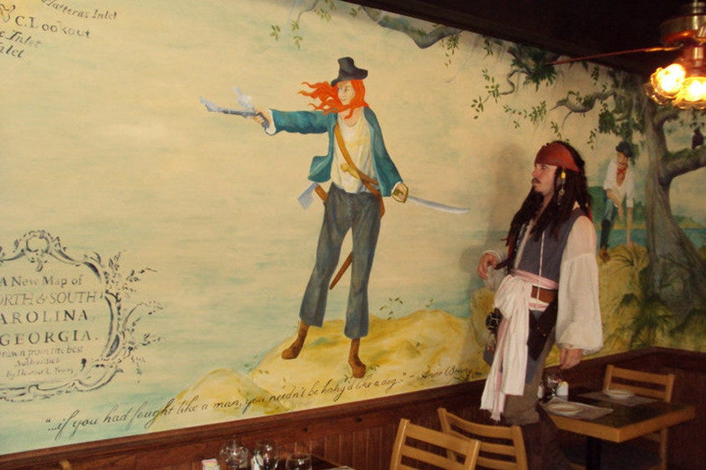 Kids love to interact with the roving pirate while they enjoy a meal at the Pirates' House.