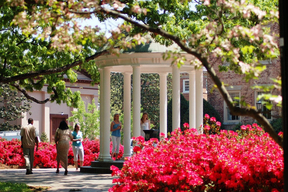 The Old Well, a symbol of UNC, stands at the heart of the university campus.