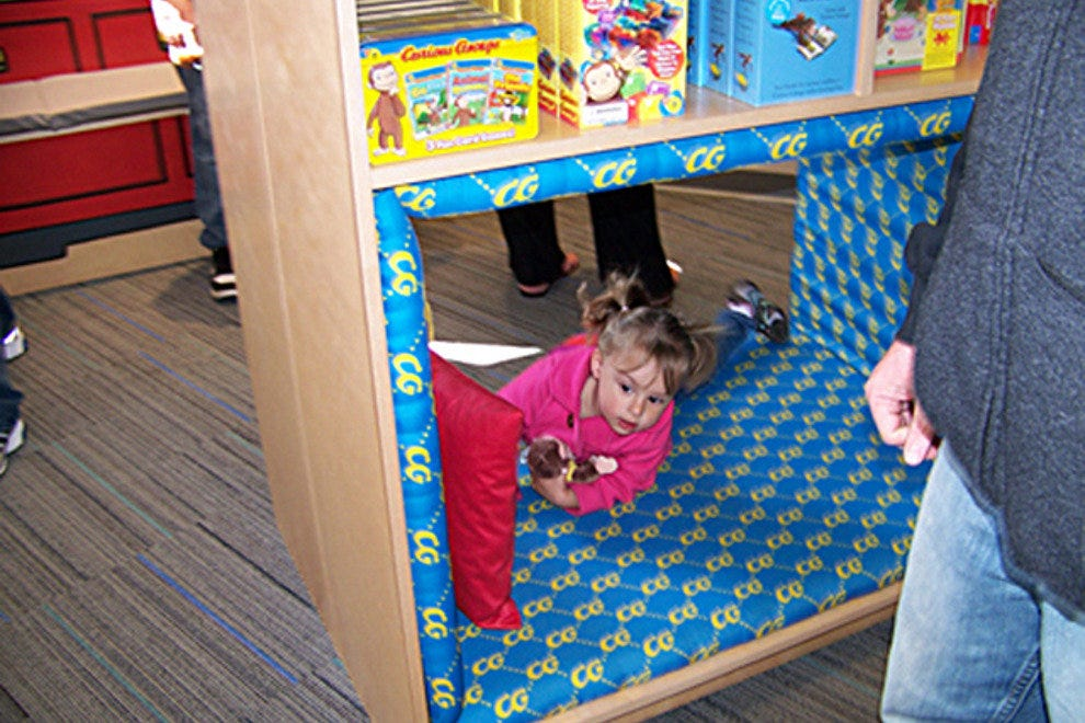 Little One at Play inside The Curious George Store