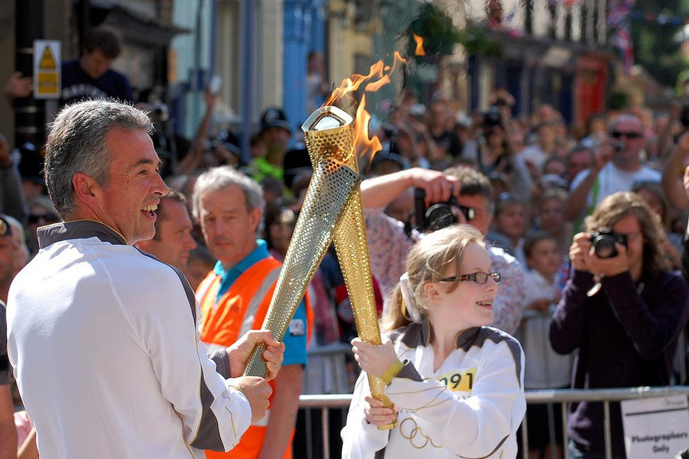 Handing over Olympic torch flame