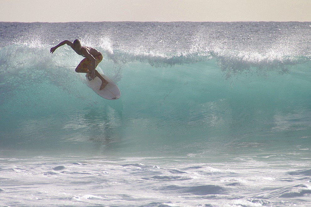Surfing in posh Boucan Canot