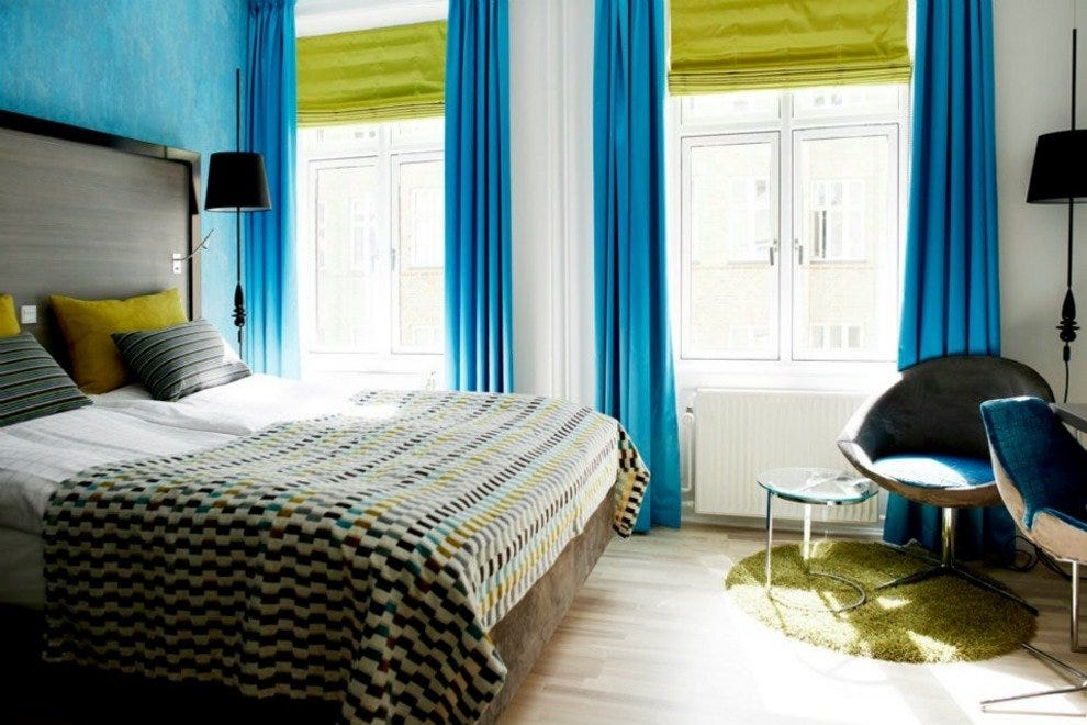 Andersen Hotel's 'Mermaid' rooms are decorated in water tones of rich turquoise and lime.