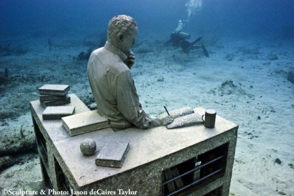 One of the several hundred statues in Cancun's Underwater Museum
