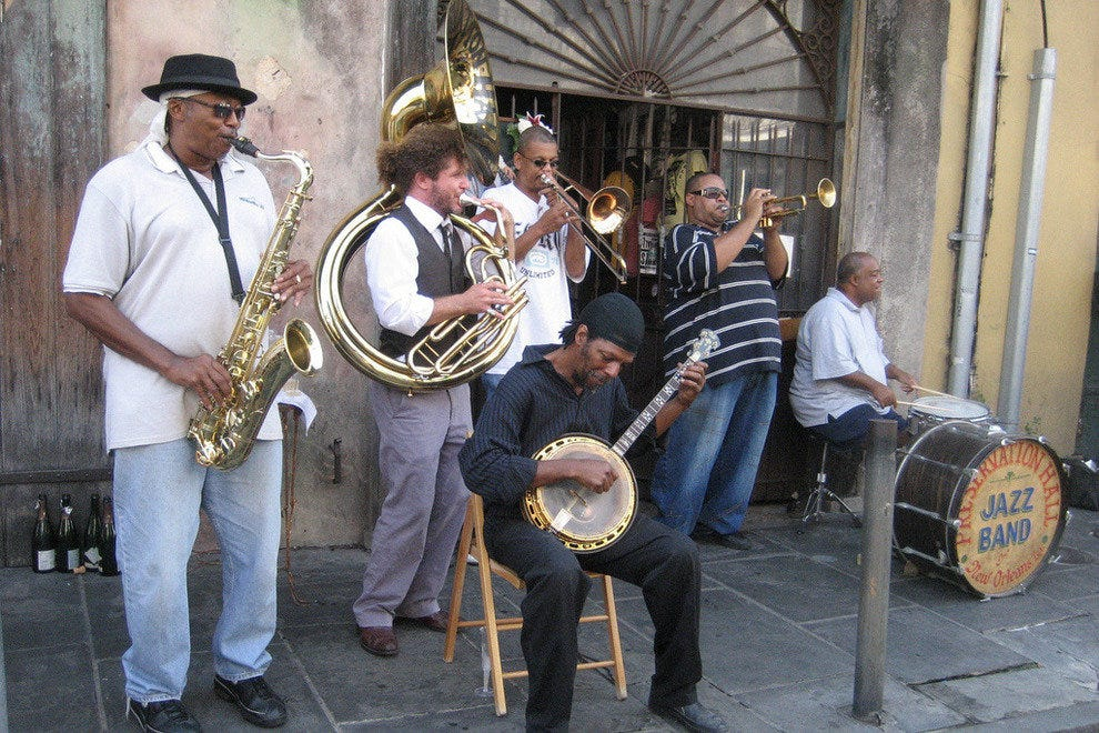 Preservation Hall Jazz Band playing on St. Peter Street in New Orleans' French Quarter