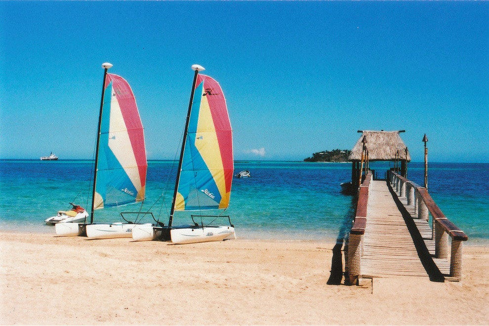 Sailboats on a Fiji beach