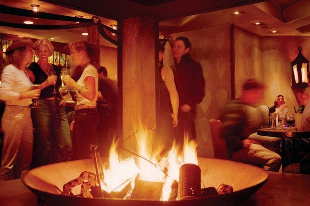 Enjoy wine by the fire at the PlumpJack Cafe in Squaw Valley