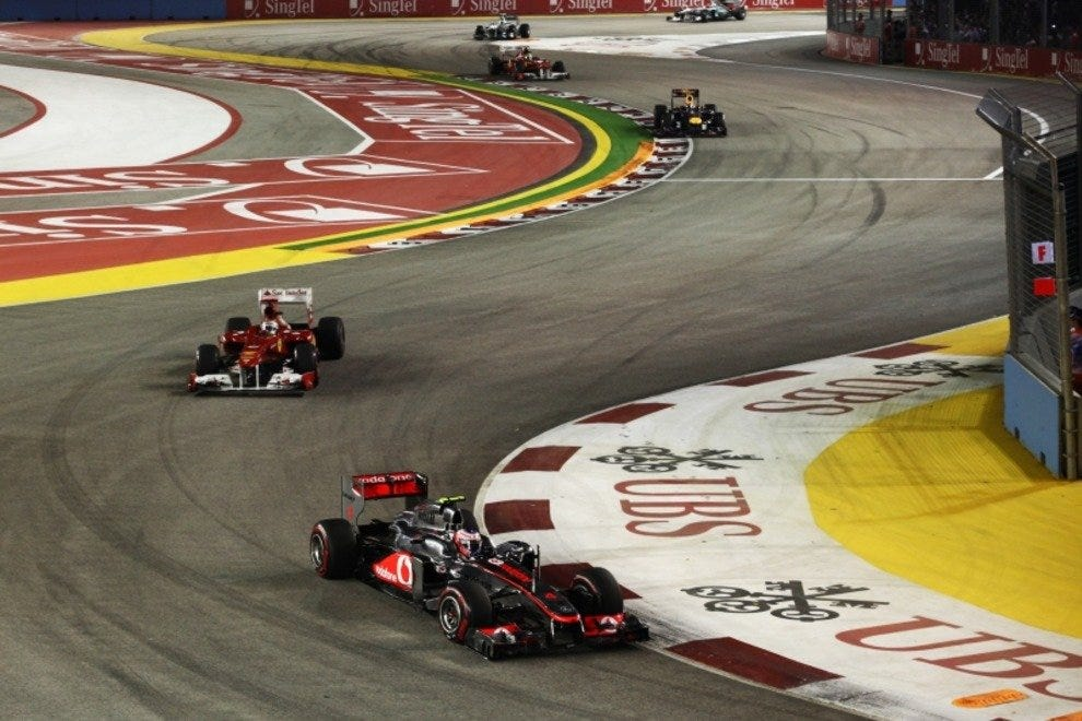 Racing heroes battle it out in the world's only Formula 1 night race
