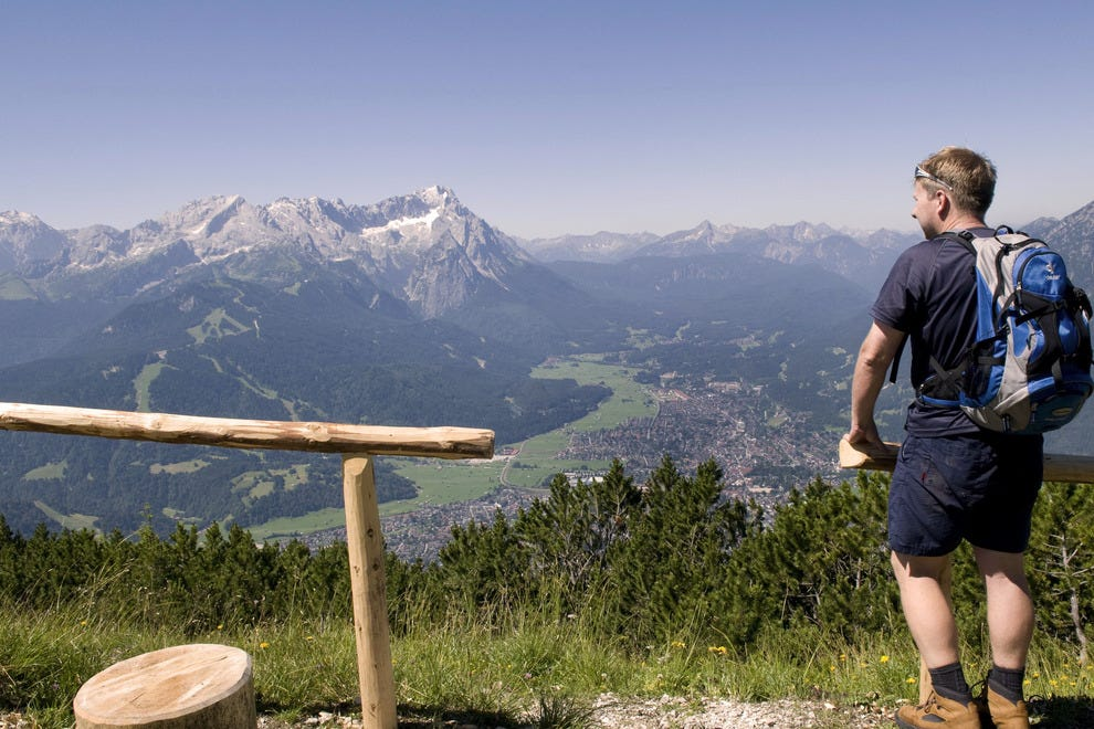 Hiker Enjoying Alpine View, Bavaria, Germany