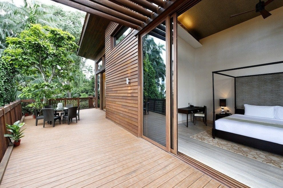 Sliding glass doors open onto a spacious 90 meter timber terrace