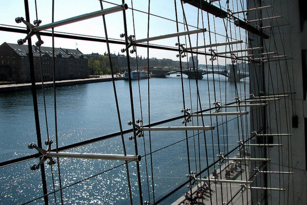 A view of Copenhagen harbor from inside the modern designed Royal Library's Black Diamond.