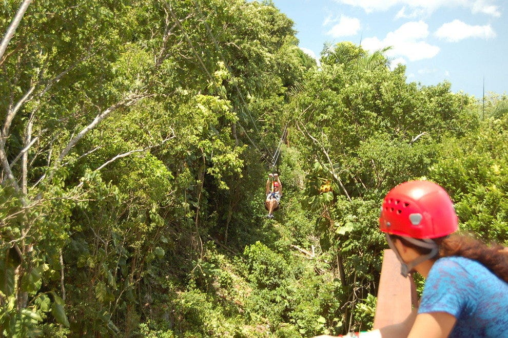 Streaking through the jungle at Tree Limin Extreme Zipline, St. Thomas