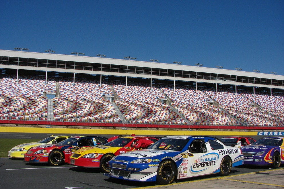 Cars lined up to be used by the NASCAR Racing Experience at Charlotte Motor Speedway