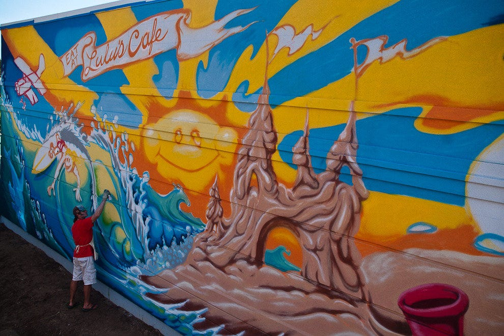 Surf-artist Drew Brophy paints a mural for Lulu's.