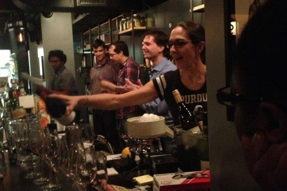 Staff members at the Drafting Table practice their bartending and pouring skills.