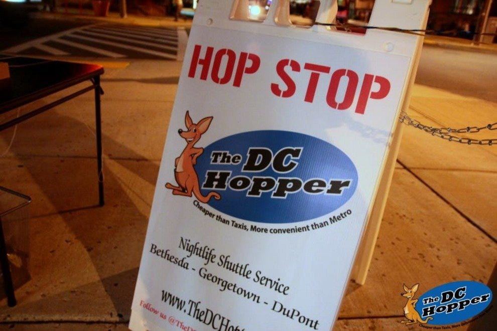 "A sign at one of the DC Hopper's ""hop stops"" lets riders know where to wait for the shuttle."