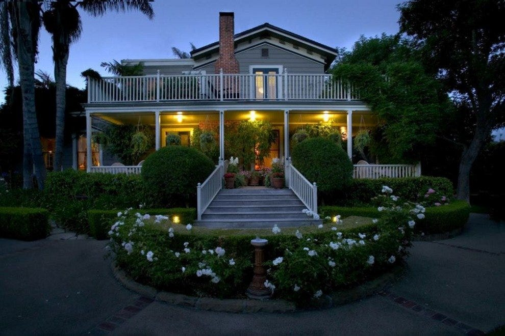 A welcoming porch and warm lights greet you upon arrival at the Simpson House Inn
