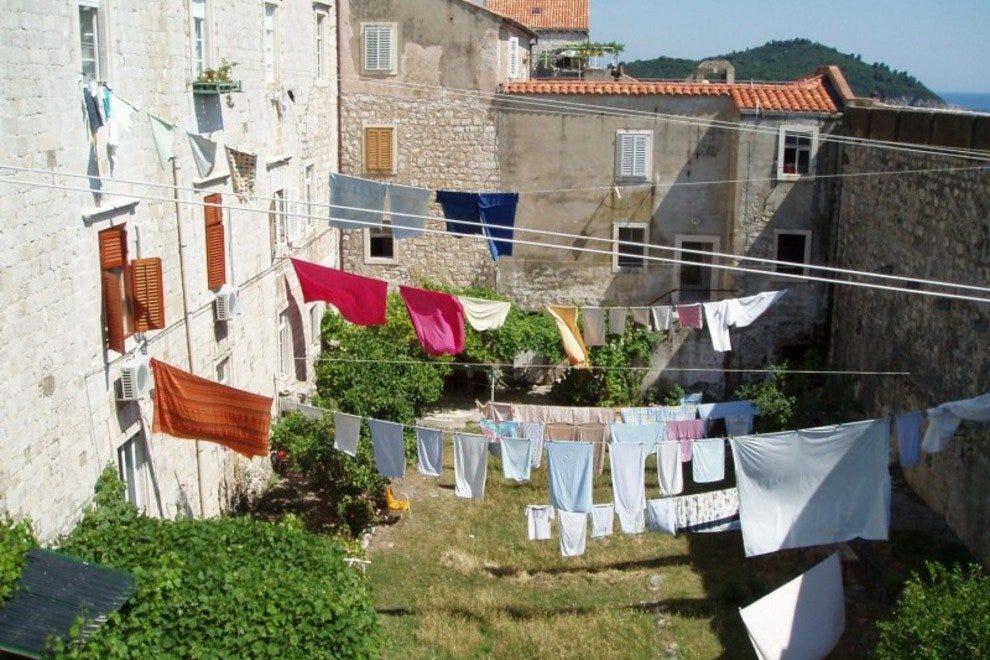 A domestic scene viewed from the wall pathway in Dubrovnik.
