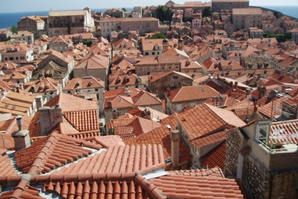 Terracotta-colored rooftops which can be seen from walking the wall.