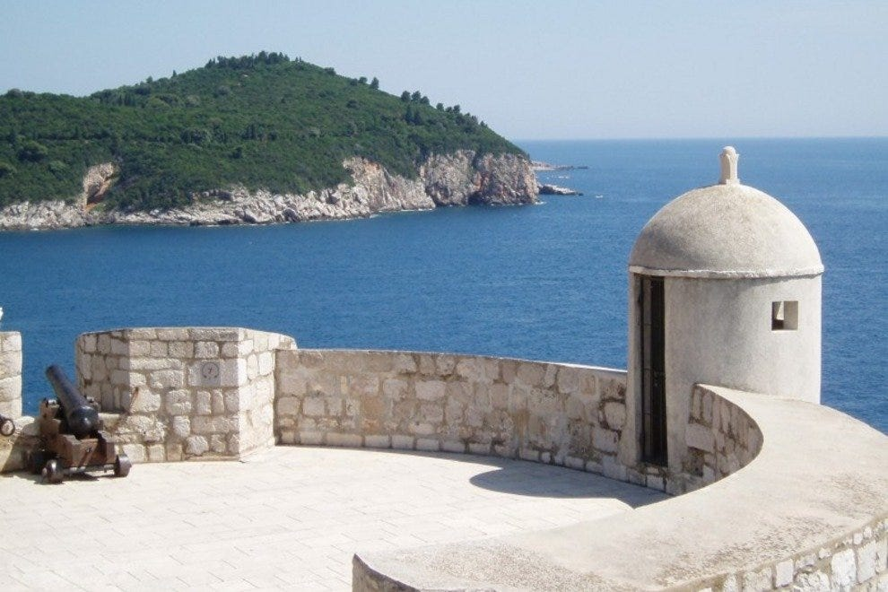 A cannon and lookout tower on the wall of Dubrovnik.