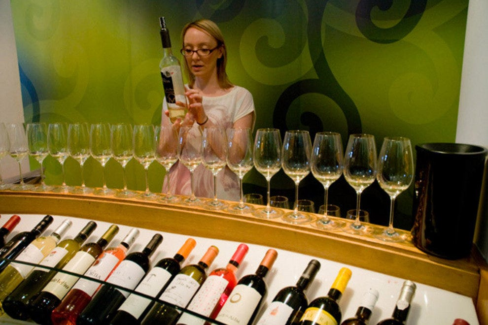 A ViniPortugal staff member prepares a wine tasting session at the Sala Ogival de Lisboa.