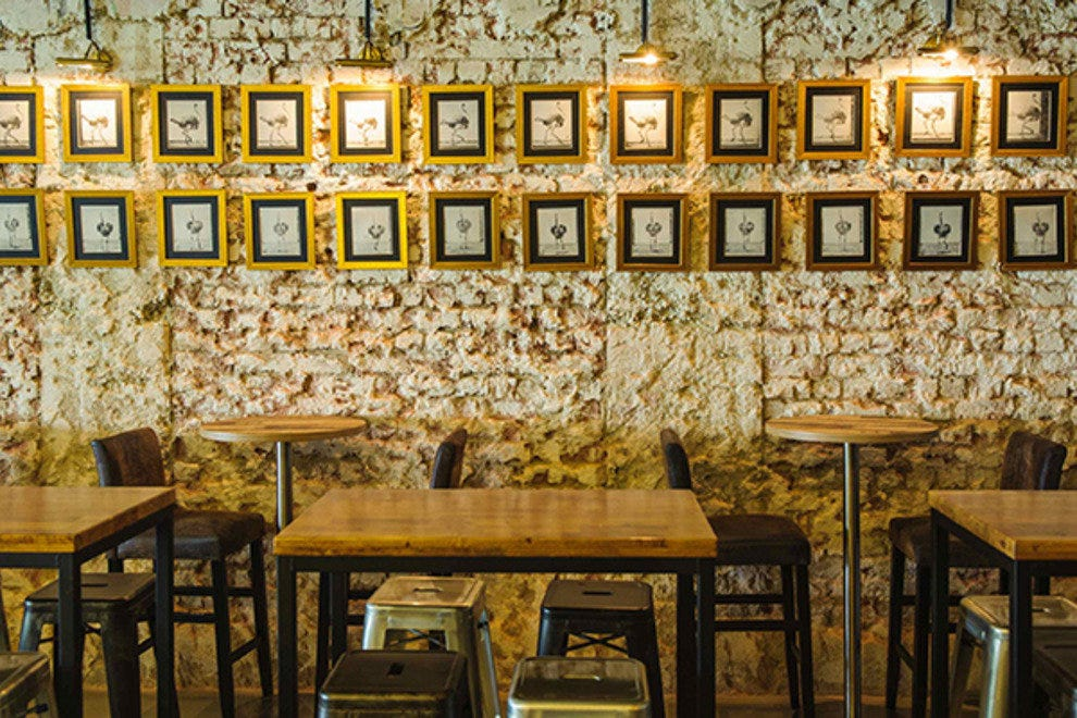 The raw industrial decor of the Coq & Balls interior