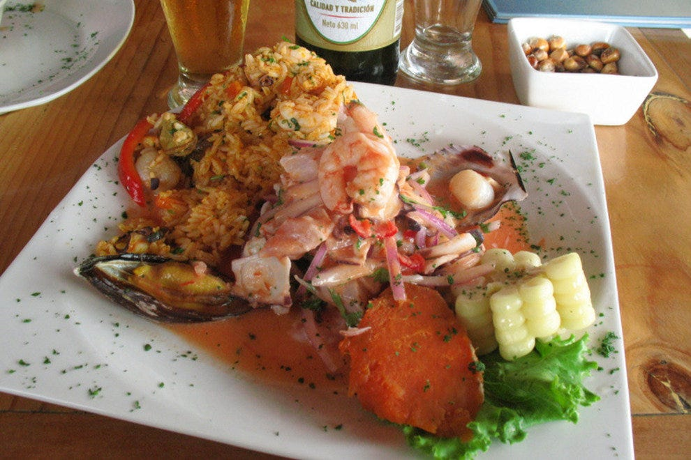 Ceviche and Arroz con Mariscos (Seafood risotto) on the same plate.