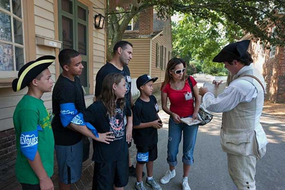 A historic reenactor speaks with a group of tourists at Colonial Wiliamsburg