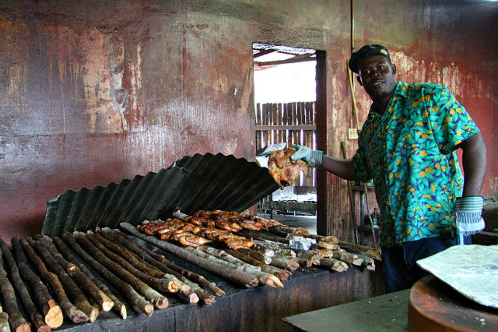 Making jerk chicken at the famous Scotchie's restaurant