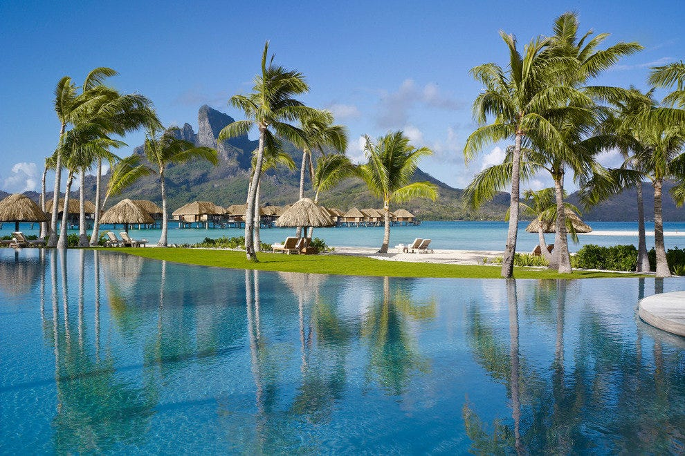 The infinity-edge pool with a view of the overwater bungalows