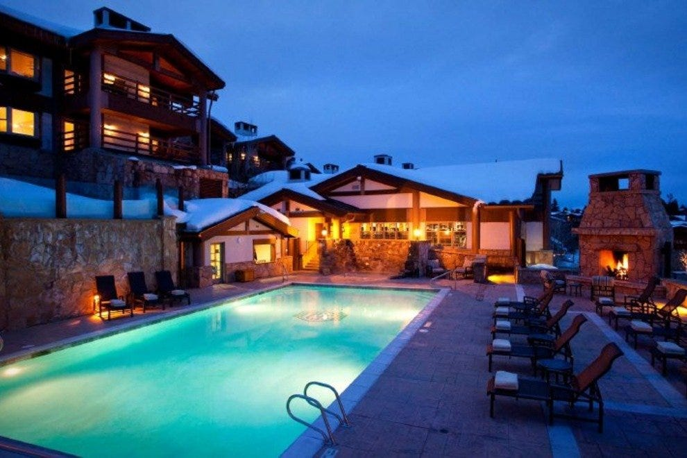 A warm pool and outdoor fireplace will soothe your muscles after a day of skiing