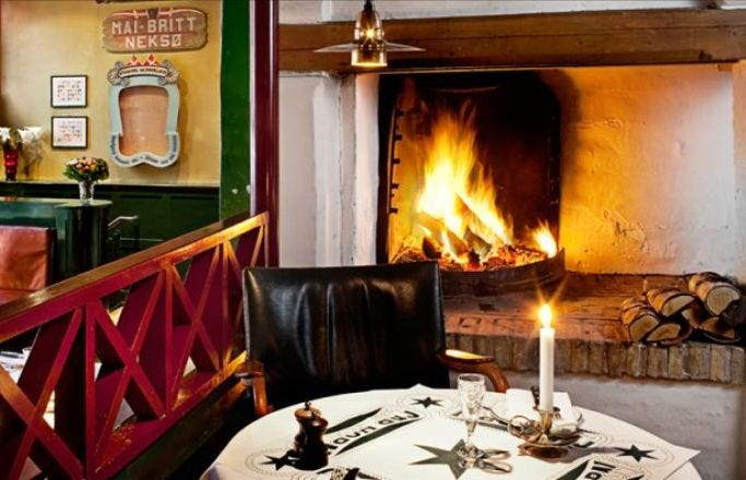 The open fireplace at Cap Horn adds to the warm, homely atmosphere.