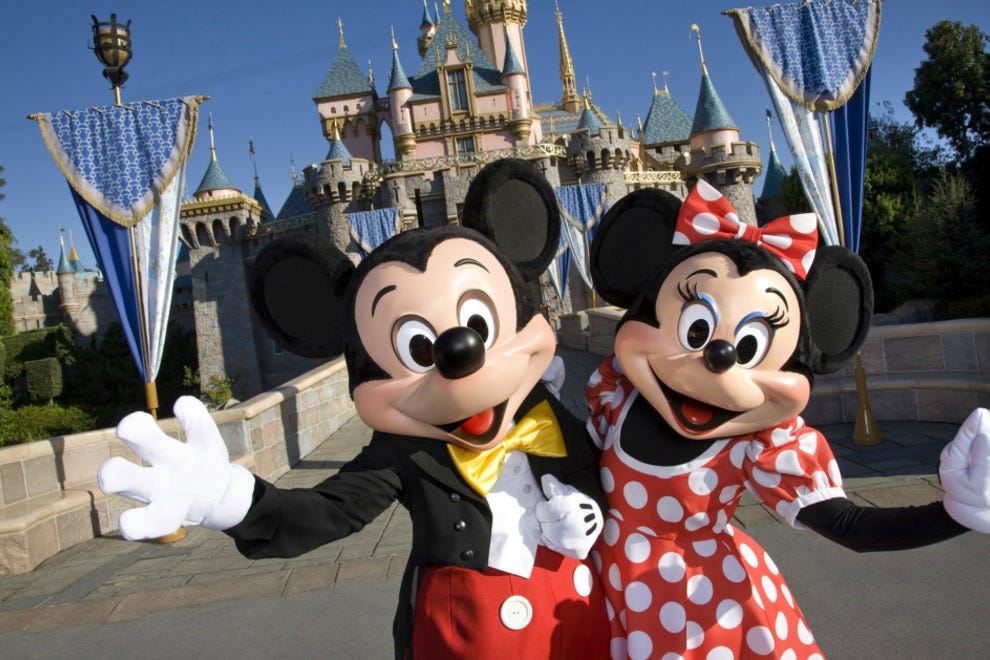 Mickey and Minnie Mouse in front of Cinderella's castle