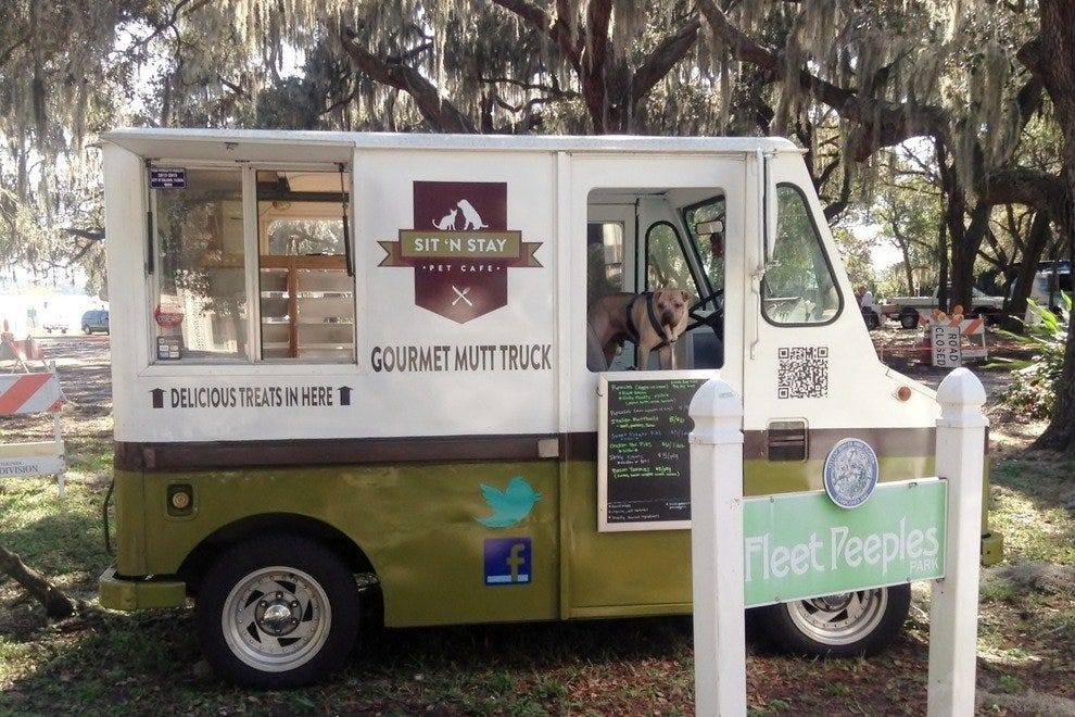 Mr. Stankins, the Mutt Truck's wrinkly rep, spreads the snacktime love at Fleet Peeples, Winter Park's canine Riviera.