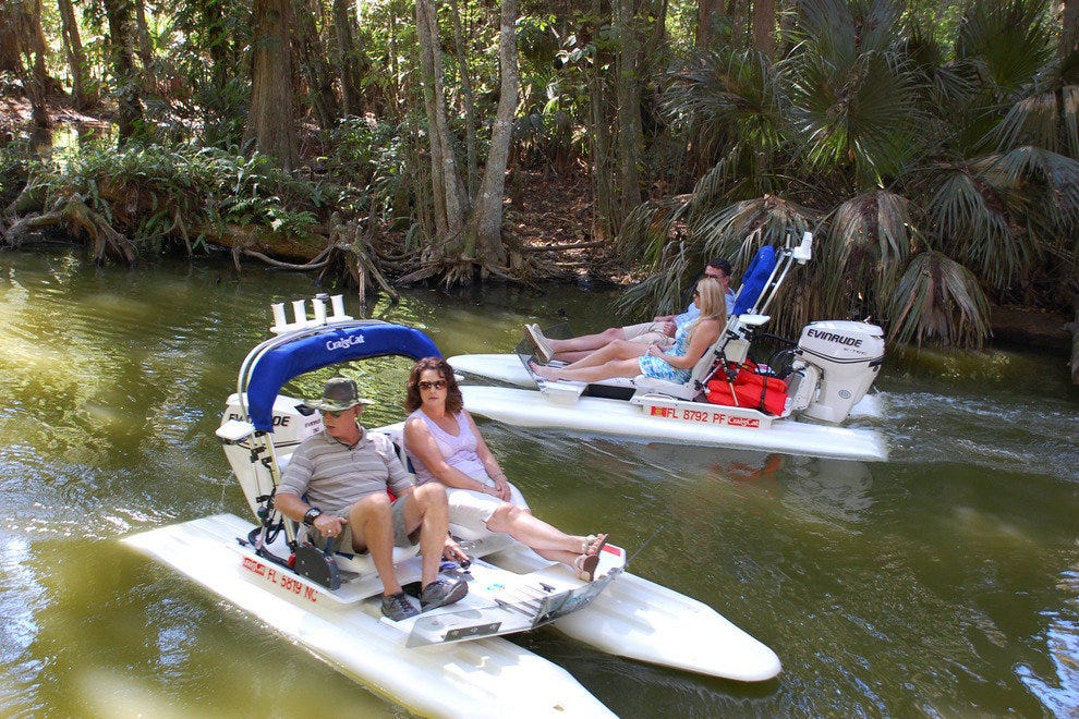 Visitors explore Mount Dora's waterways via tiny catamaran