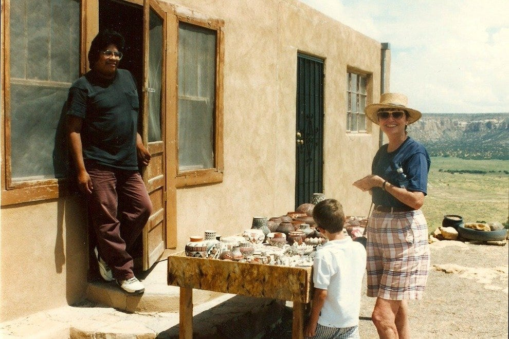 The author's mother and son purchasing pottery at Acoma