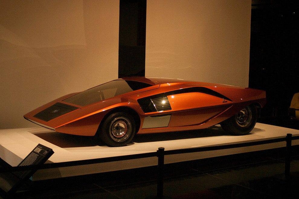 A radical Lancia Stratos Zero concept car on display at Petersen