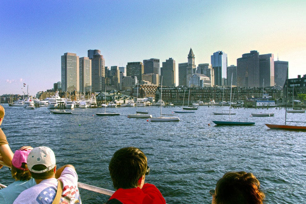 Cruise Guests Enjoy a View of Boston's Skyline from the Harbor