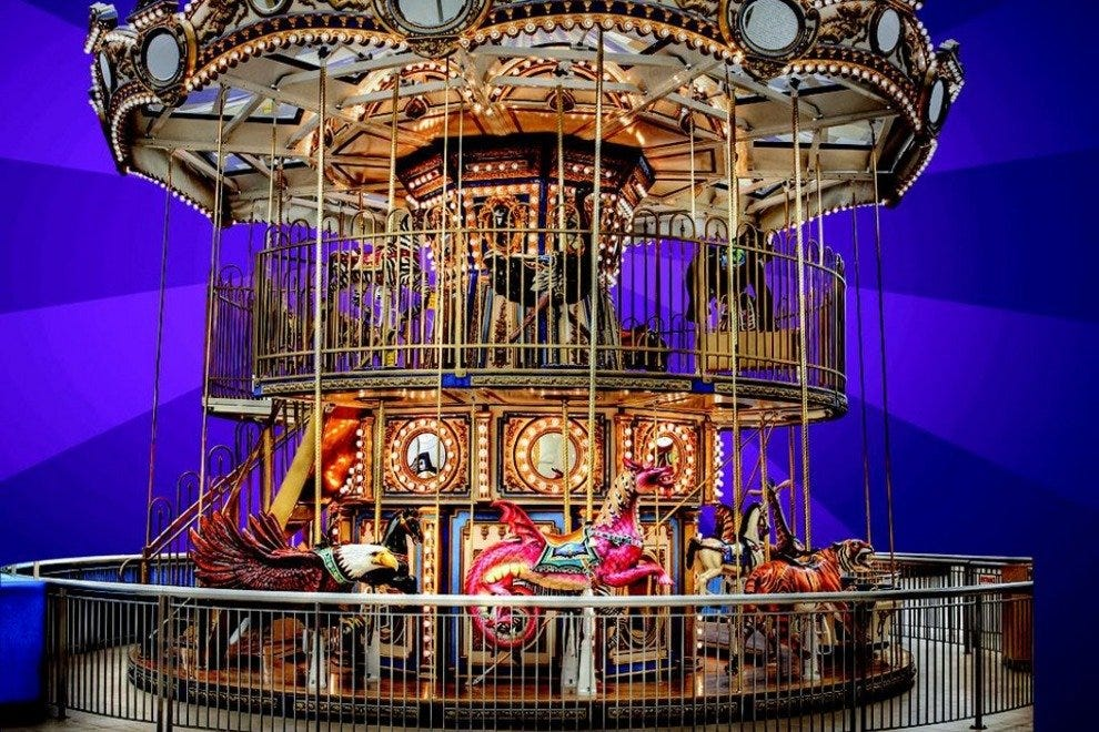 The double-decker carousel has a staircase leading to the second level.