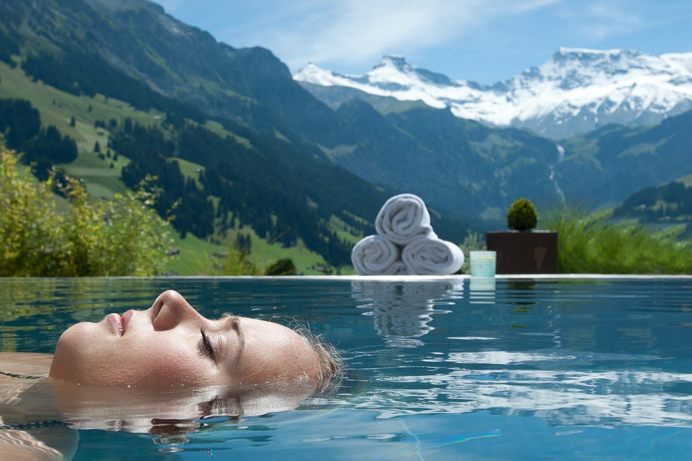 The Cambrian's infinity pool sits perched above a valley with views of the alps.