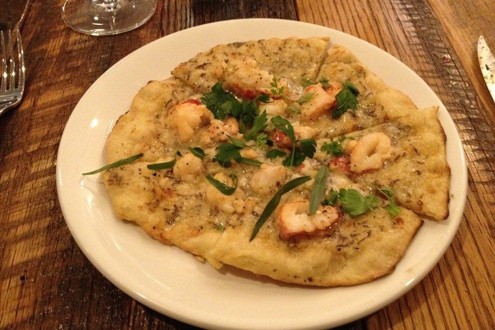 Try a local specialty - like the fresh ridge back shrimp pizza at Anchor Woodfire Kitchen
