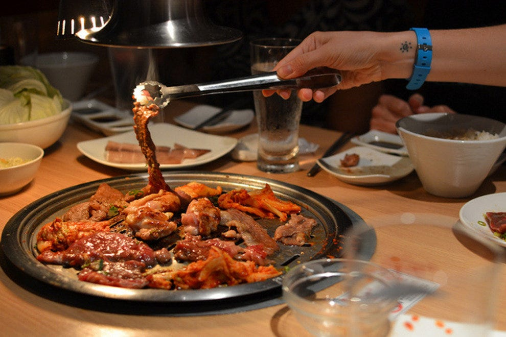 Korean barbecue is cooked at your table