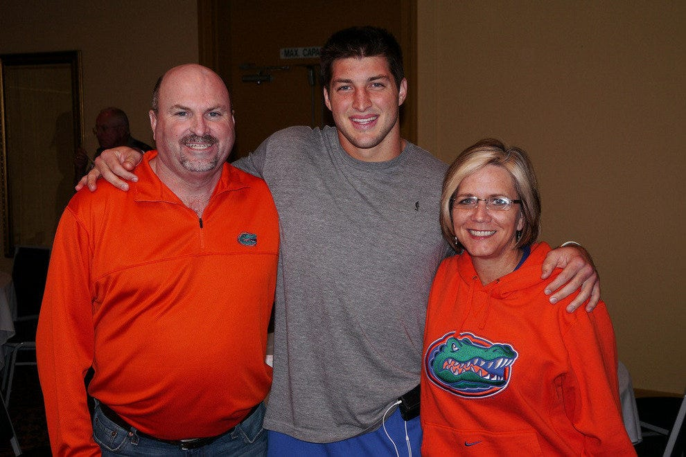 Tim Tebow poses for a photo with Florida Gators fans