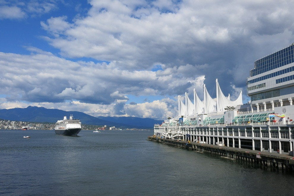 A cruise ship departs Canada Place
