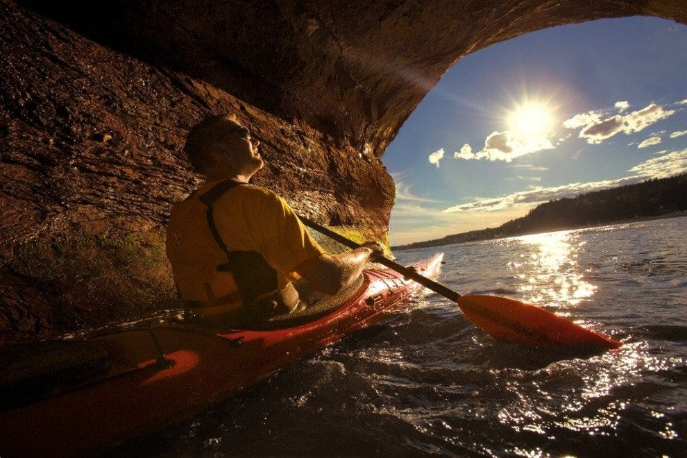 Kayaker in St. Martins Cave at high tide