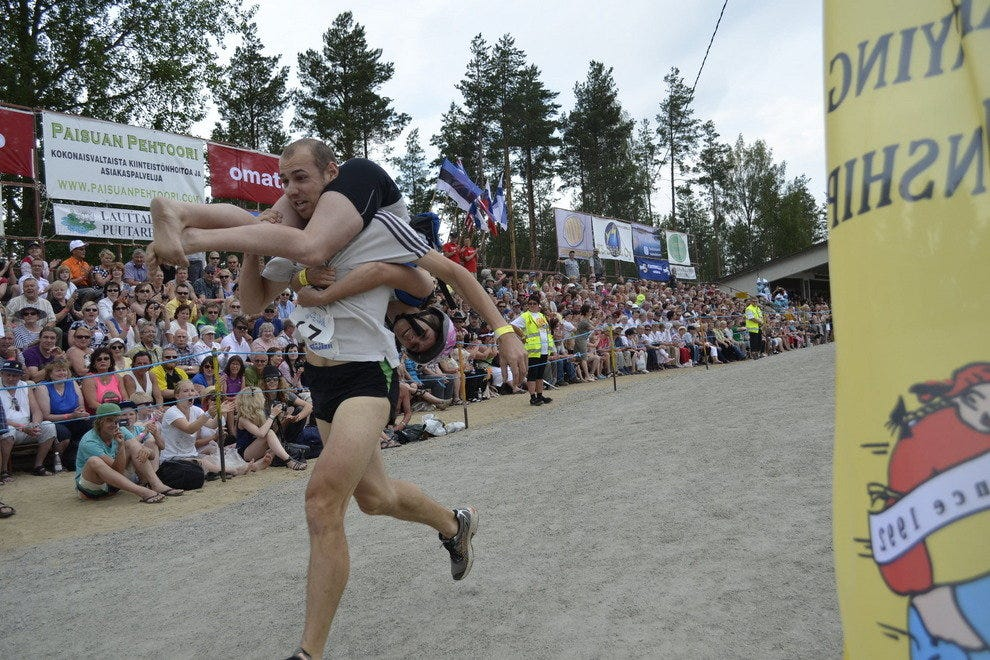 A participant races with his wife toward the finish line